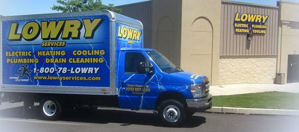 Lowry Services Truck in front of building